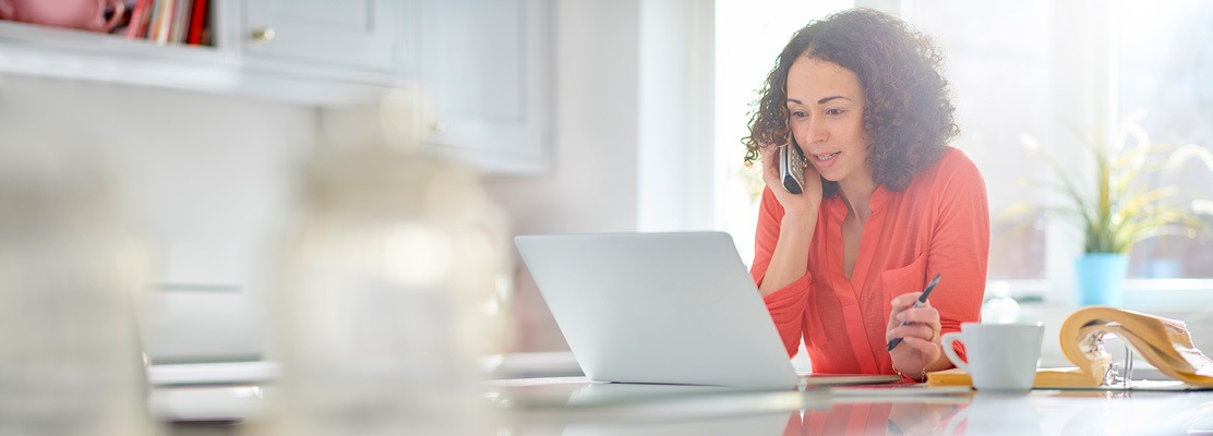 Woman sitting on laptop calling someone