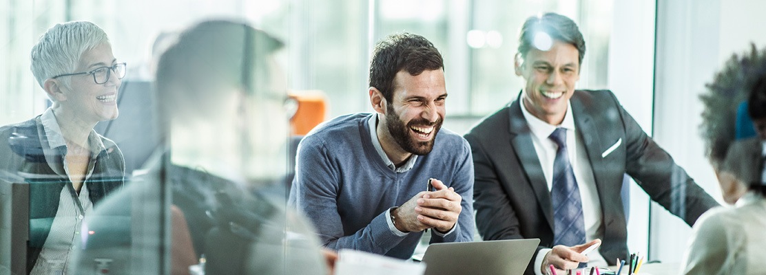 Business People Sitting at table laughing